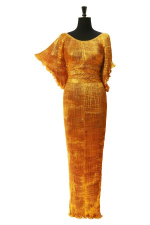 Golden Lady Lauder in Buried Treasure Gold Hand Pleated Silk